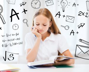 education and school concept - little student girl studying at s